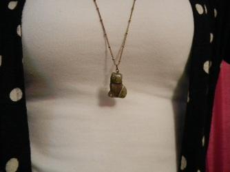 Close-up Christina's cat necklace | Christina's Best Life